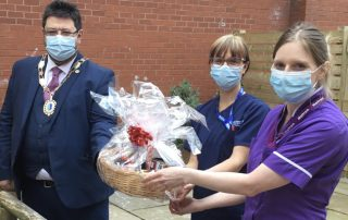 Mayor of Dalton Nick Perie presents a cheque and hamper to Ward Manager Helen Steer and Matron Debbie Muldoon-Smith.