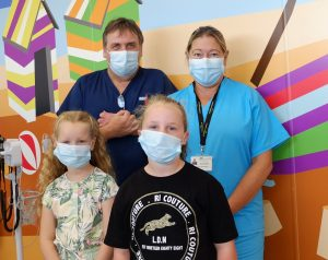 Emme-Rose (left) and Lilli-Mae with Emergency Department Manager Chris Wilson and Executive Chief Nurse and Deputy Chief Executive Sue Smith OBE.